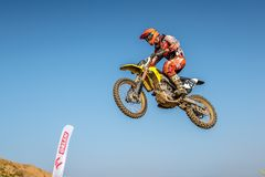Всадник Motocross в гонке Стоковое Фото