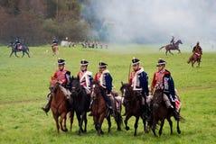 Всадники лошади на Бородино сражают исторический reenactment в России Стоковые Изображения