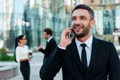 Всегда в контакте с его клиентами Стоковая Фотография RF