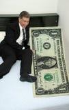 всесильный доллар бизнесмена кровати жадный Стоковое Изображение RF