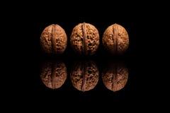 3 всех грецкого ореха изолированного на черной предпосылке Стоковое фото RF