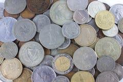 все монетки над миром студии съемки Стоковые Изображения