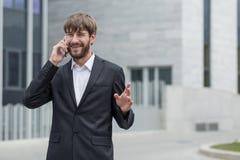 Вскользь беседа над телефоном Стоковое Фото