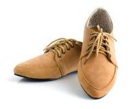 Вскользь коричневые кожаные unisex ботинки стоковое изображение rf