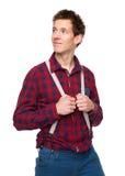 Вскользь парень держа подтяжки и смотря прочь Стоковая Фотография RF