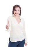 Вскользь усмехаться женщины показывая как или жест большого пальца руки-вверх и Стоковое Изображение