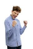 Вскользь человек выигрывая и празднуя стоковое фото rf