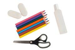 Вспомогательное оборудование Shool, карандаш, истиратель, клей, ножницы стоковое фото rf