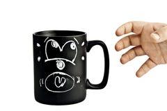 вспугнутая рука чашки Стоковое Фото