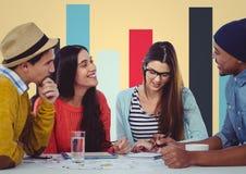 Встречать таблетку и бумагу против красочной диаграммы и желтой предпосылки Стоковое Изображение