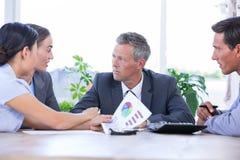 Встреча бизнесмена при коллеги используя компьтер-книжку Стоковая Фотография RF