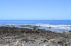 Вулканическая порода пляжа Playa De Las Америк Стоковые Изображения RF