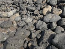 Вулканические камни в различных размерах Стоковое Изображение