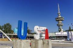 Вход Thessaloniki, Греции к 83rd международной ярмарке с большим знаком США Стоковые Изображения