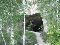 Вход к пещере Пещера в утесе Стоковые Изображения