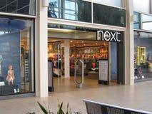 Следующий вход магазина одежды. Стоковое фото RF