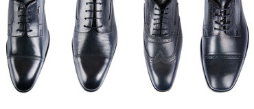 Выбор мужских ботинок изолированных на белизне Стоковое фото RF