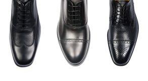 Выбор мужских ботинок на белизне Стоковые Фотографии RF