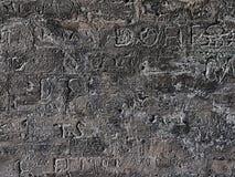 Выгравированные сочинительства стены стоковые фото
