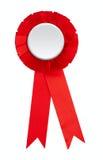 выигрывать розетки тесемки пожалования изолированный пробелом красный Стоковые Фото
