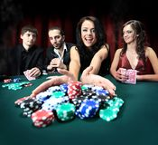Выигрыши женщины в казино стоковое фото rf