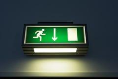 Выйдите знак на стене Стоковая Фотография RF