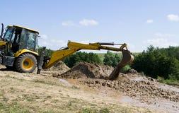 выкапывая землечерпалка Стоковая Фотография