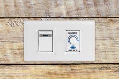 Выключатель на деревянной стене Стоковые Изображения