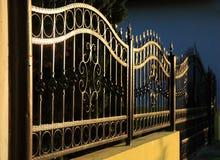 Выкованная железная загородка стоковая фотография