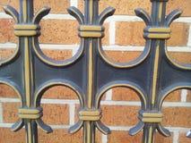 Выкованные элементы декоративный обрабатывать загородки металла стоковая фотография rf