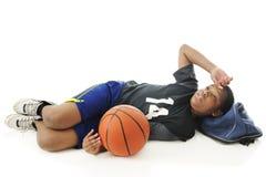 Вымотанный молодой спортсмен Стоковые Фото