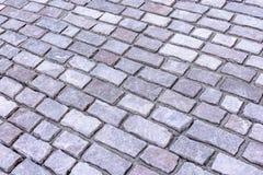 Вымощая камни лежат раскосно, предпосылка Стоковое Изображение RF