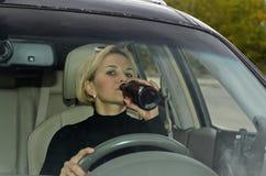 Выпивая женщина Стоковые Фото