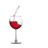 Выплеск бокала Красное питье брызгая в Стоковое Изображение
