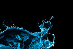 Выплеск воды изолированный на черной предпосылке Стоковые Фото