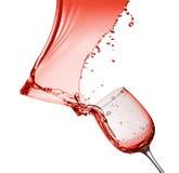 Выплеск красного вина от стекла изолированного на белой предпосылке Стоковая Фотография