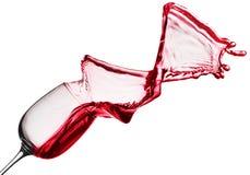 Выплеск красного вина от стекла изолированного на белой предпосылке Стоковые Фотографии RF