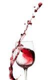 Выплеск красного вина от стекла изолированного на белой предпосылке Стоковые Изображения