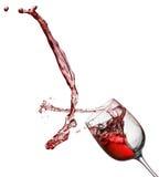 Выплеск красного вина от стекла изолированного на белой предпосылке Стоковые Фото