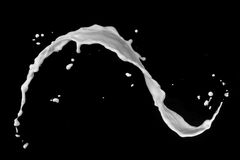 Выплеск молока изолированный на черноте Стоковое Изображение RF