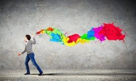 Выплеск молодого человека и цвета Стоковое Изображение RF