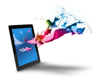 Выплеск цвета компьютера таблетки Стоковое Фото