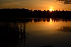 Выравнивать заход солнца ландшафта Стоковая Фотография RF