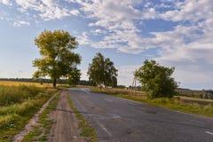 Выравнивать ландшафт вне города на заходе солнца Стоковое фото RF