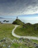 Выравнивать свет на маяке Mawr Twr на острове Llanddwyn, Anglesey, Великобритания стоковое изображение