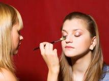 Выражение лица - молодые женщины над красной предпосылкой Стоковые Фотографии RF