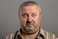 Выражение лица удивленного человека Стоковое фото RF