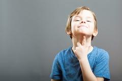 Выражения мальчика - смешная думая сторона Стоковые Изображения