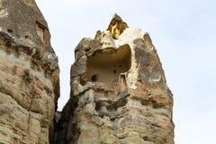 вырезанный в скале дом в fairy утесе печной трубы в Goreme Стоковое фото RF