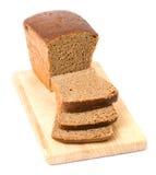 вырезывание коричневого цвета хлеба доски Стоковые Фотографии RF